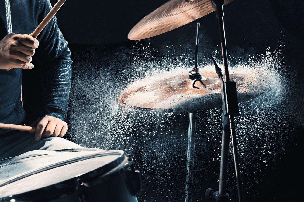 Man recording music on drum set in studio